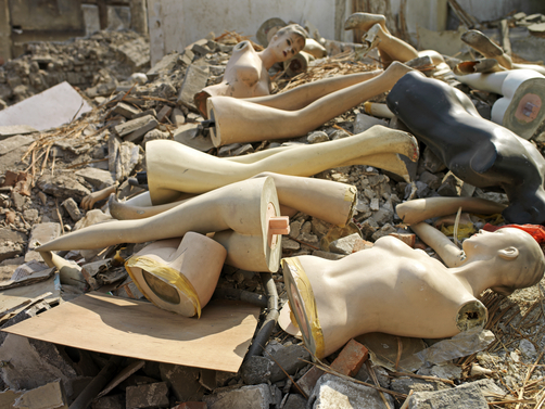 Mannequins lie in a pile of rubble in Beijing, China
